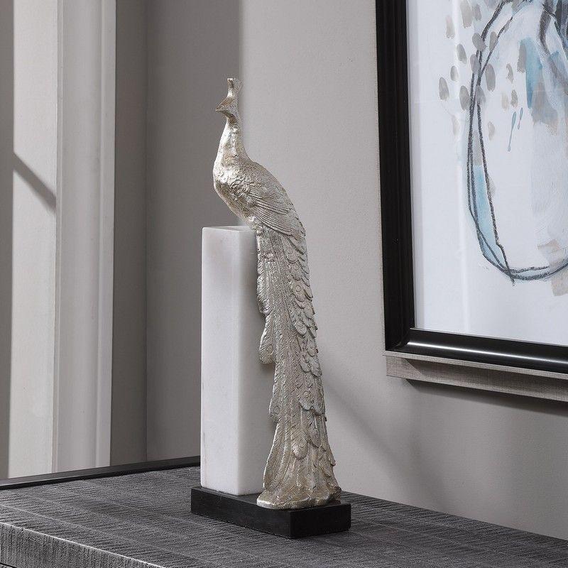silver peacock sculpture